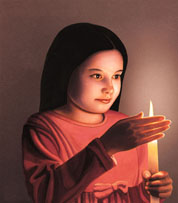 Photo of a child with a candle